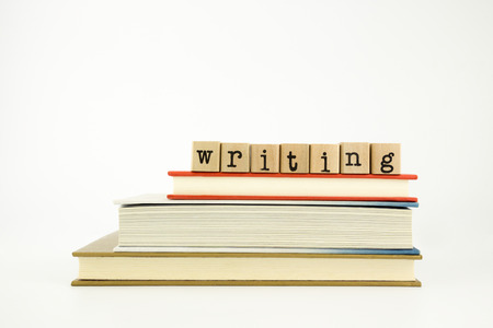 writing word on wood stamps stack on books, study and academic concept