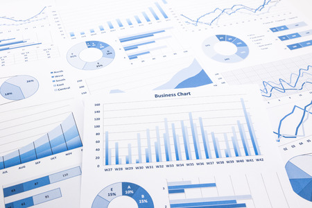 blue business charts, graphs, reports and paperwork for financial and business concepts