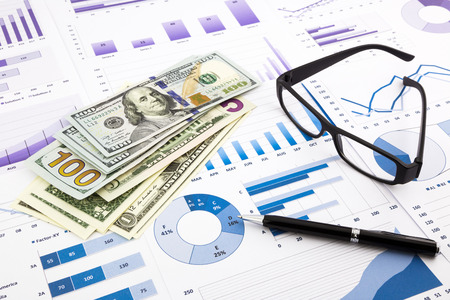 dollar currency on financial charts, expense cash flow summarizing and graphs background, concepts for saving money, budget management, stock exchange and business income report