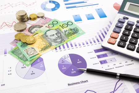 australia dollar currency on financial charts, expense cash flow summarizing and graphs background, concepts for saving money, budget management, stock exchange, investment and business income report