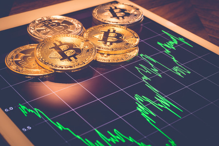 Photo pour Cryptocurrency, focus Bitcoin on tablet screen that showing green price or stock market performance graph, light reflect with vintage filter. Decentralized, exchange digital money through blockchain. - image libre de droit