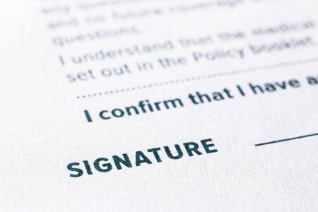 Photo pour Close up word signature on business agreement form. Policy documents, registration, employment and commercial startup concept. - image libre de droit