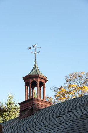 Aging cupola with weathervane