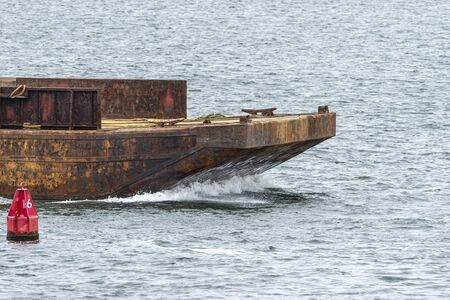 Photo pour Bow of barge being pushed toward hurricane barrier in New Bedford, Massachusetts - image libre de droit