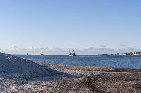 Photo pour Departing fishing boats seen from Fort Phoenix shoreline - image libre de droit