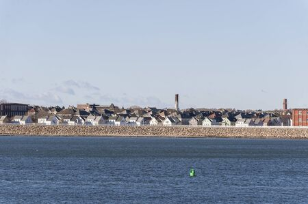 Photo pour Waterfront residential neighborhood tucked behind New Bedford hurricane barrier - image libre de droit