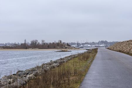 Photo pour Access road along New Bedford side of hurricane barrier open to pedestrians and cyclists - image libre de droit