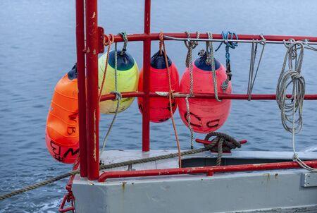 Photo pour Colorful floats hanging off port side of New Bedford lobster boat - image libre de droit