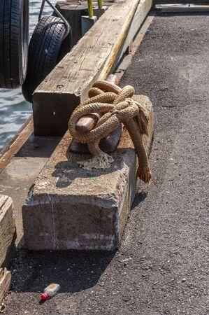 Photo pour Cleated line and nip bottle on wharf - image libre de droit