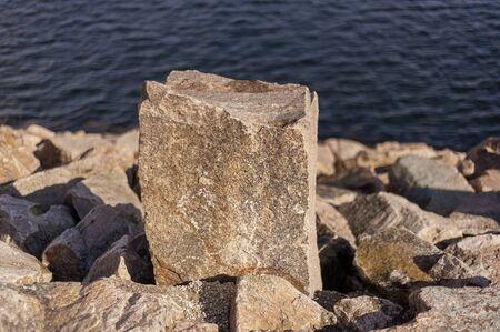 Photo pour Granite stone set as marker along service road on hurricane barrier across New Bedford harbor - image libre de droit