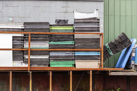 Photo pour New Bedford, Massachusetts, USA - October 13, 2018: Stacks of well-used fish totes on New Bedford waterfront - image libre de droit
