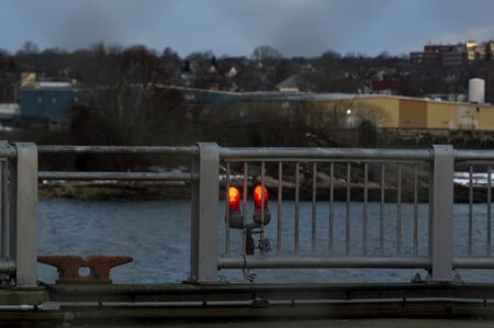 Photo pour Warning lights marking side of hurricane barrier glow in morning semi-darkness - image libre de droit