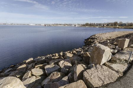 Photo pour Wide-angle view of Fairhaven shoreline of New Bedford harbor with hurricane barrier in foreground - image libre de droit