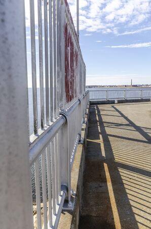 Photo pour Iron fence on hurricane barrier in New Bedford harbor - image libre de droit