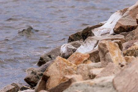 Photo pour Salt water spray frozen on hurricane barrier rocks in New Bedford harbor - image libre de droit