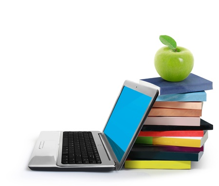 Books and laptop isolated on white background