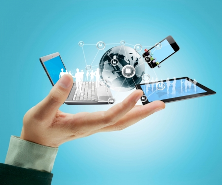 Photo pour Technology in the hands of businessmen - image libre de droit