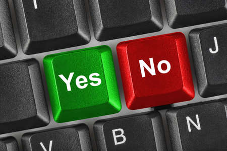 PC keyboard with Yes and No keys - business concept
