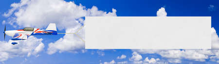 Photo pour Flying airplane and banner - sky on background - image libre de droit