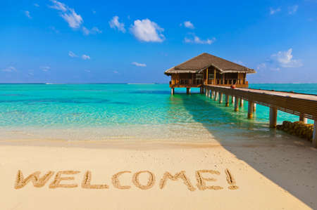 Photo for Word Welcome on beach - nature holiday background - Royalty Free Image