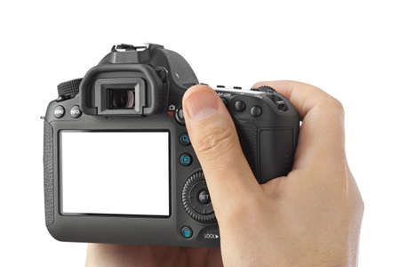 Photo pour Photo camera in hand isolated on white background - image libre de droit