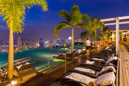 Photo for Pool on roof and Singapore city skyline - Royalty Free Image