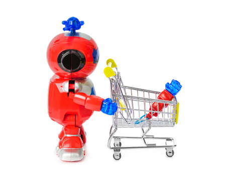 Photo pour Toy robot and shopping cart with hand isolated on white background - image libre de droit