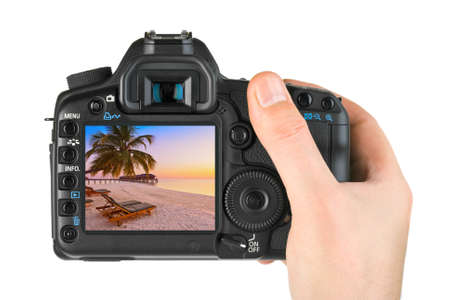 Photo pour Hand with camera and Maldives beach photo (my photo) isolated on white background - image libre de droit