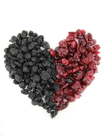 Heart of dried blueberries and cranberries isolated on white background