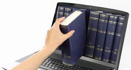 Photo pour Laptop computer with books, isolated on white  - image libre de droit