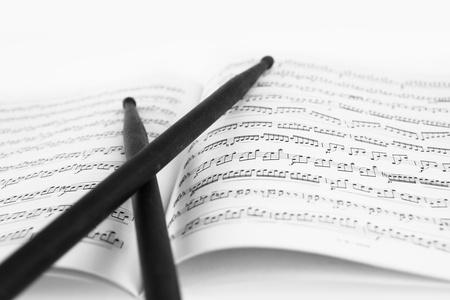 Drum sticks on the music sheet