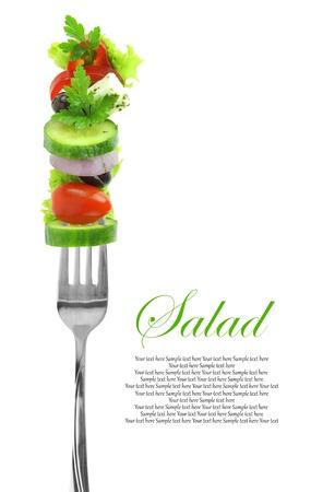 Fresh mixed vegetables on fork