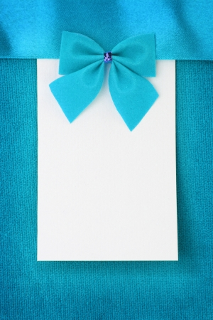 Blank paper greeting card on blue background