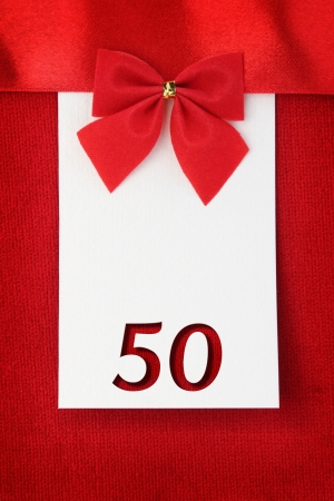 Number fifty on red greeting card