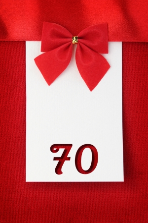 Number seventy on red greeting card