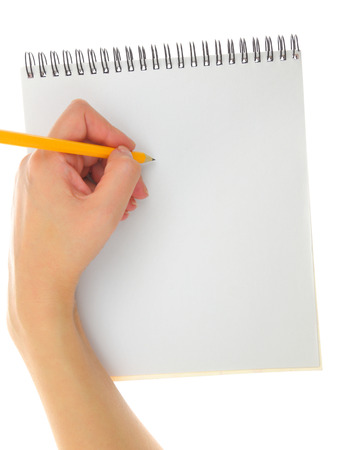 Hand drawing gesture with pencil and pad isolated