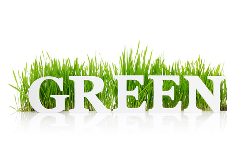 Word Green with fresh grass isolated on white