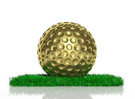 Gold golf ball on patch of green grass