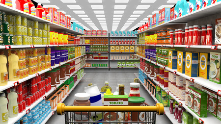 Supermarket interior, shelves with various products and full  trolley basket
