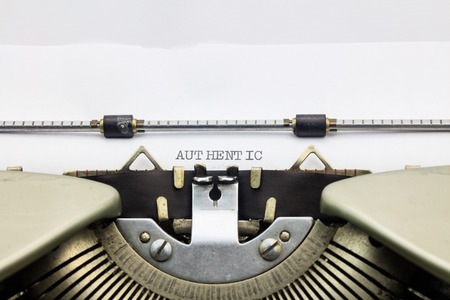 Photo pour Close-up of word Authentic on typewriter sheet - image libre de droit