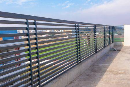 Photo pour Steel railing on the house traces on blue sky background. - image libre de droit