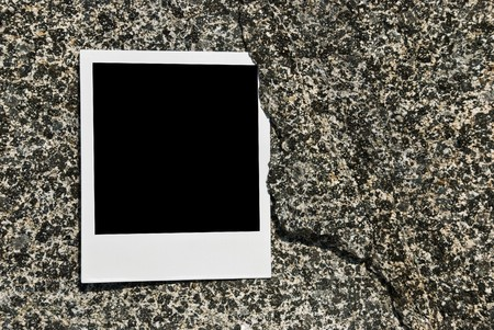 Blank card with shadow on the stone wall
