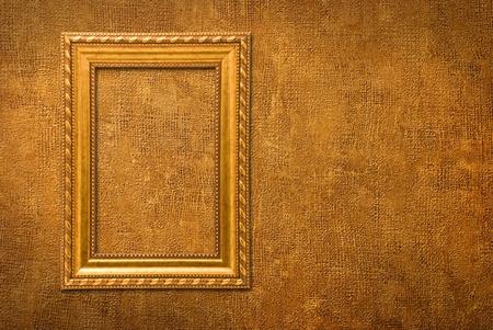 Photo pour Gold frame on a yellow wall background - image libre de droit