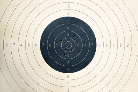 Photo for Target with numbers for shooting at a shooting range. A round target with a marked bulls-eye for shooting practice on the shooting range. Target with bullet holes - Royalty Free Image