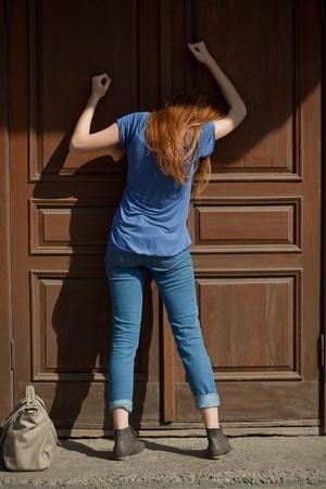 she bangs on the door