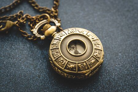 Photo for Detail of a metal pocket watch with horoscope design - Royalty Free Image