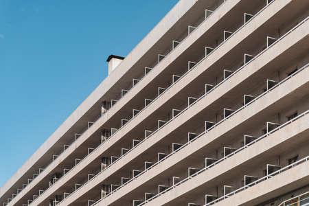Photo pour Rows of balconies of an urban contemporary building in diagonal view - image libre de droit