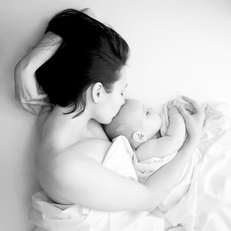 Photo for Black and white portrait - a young mother and her baby sleeping in bed. The symbol of maternal love, care, happiness and pacification - Royalty Free Image
