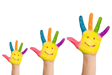 Three colorful hands with smile of family - mother, father and baby