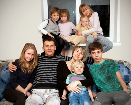 Happy big family. Father, mother and seven children at home. Family concept.